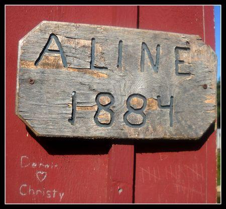 Aline covered bridge sign